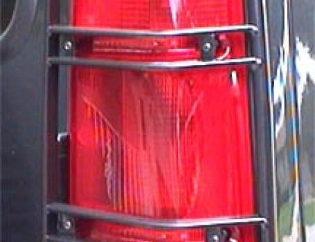 1999-2004 DISCO. REAR UPPER LAMP GUARDS